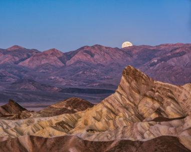 """Today's Photo Of The Day is """"Moonset Zabriskie Point"""" by Rebecca Gillum. Location: Death Valley National Park, CA."""