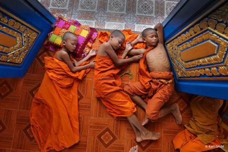 Novice Monks Sleeping In Doorway By Karl Grobl
