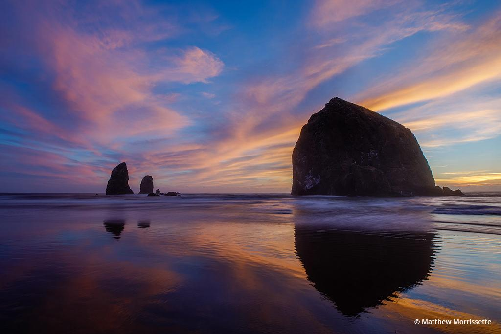 """Today's Photo Of The Day is """"Sunset Reflections of Haystack Rock"""" by Matthew Morrissette. Location: Cannon Beach, Oregon."""
