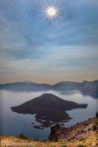 "Today's Photo Of The Day is ""Eclipse Over Wizard Island"" by NewmanImages. Location: Crater Lake National Park, Oregon."
