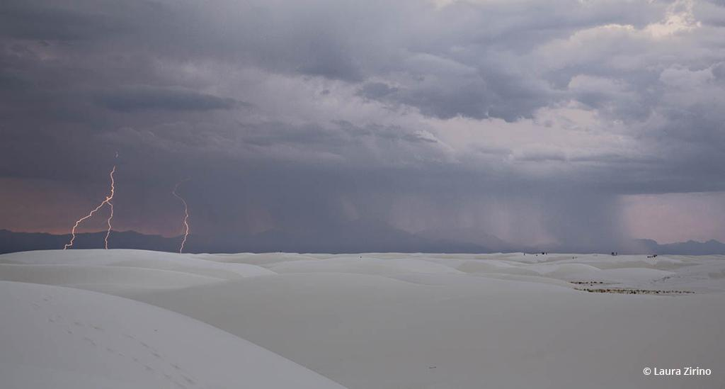"Today's Photo Of The Day is ""Watching the Storm"" by Laura Zirino. Location: White Sands National Monument, New Mexico."
