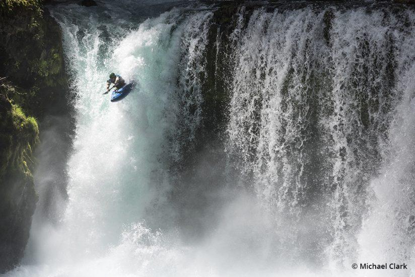 Adventure sports photography, kayaking over falls