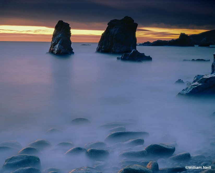 long exposure of ocean surf just after sunset