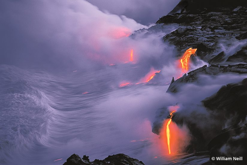 Image of Lava flow entering the sea at twilight, Hawaii Volcanoes National Park, Hawaii, 1994.