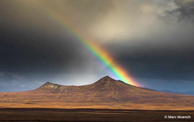 Art of luminosity rainbow over mountains