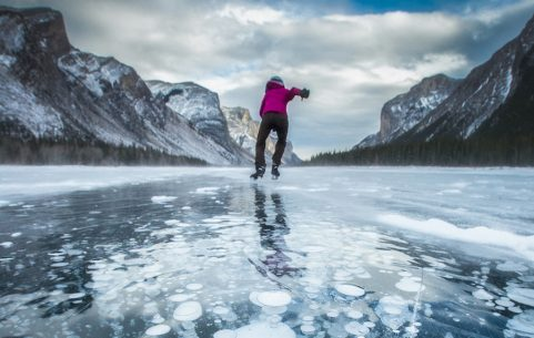 Image of a skater on a frozen lake.