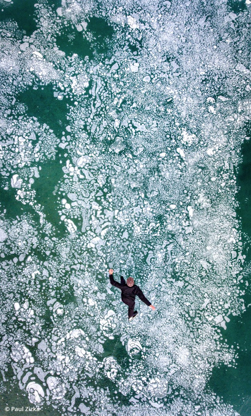 Aerial view of the photographer skating over a frozen lake.