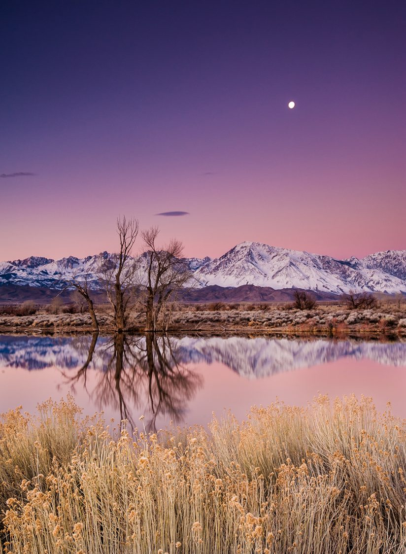 Image of the full moon at dusk in the Eastern Sierras.