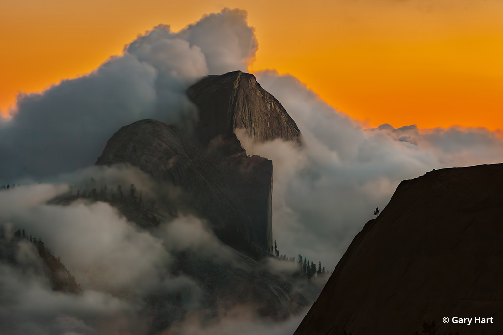 Sunset photo of Half Dome and clouds.