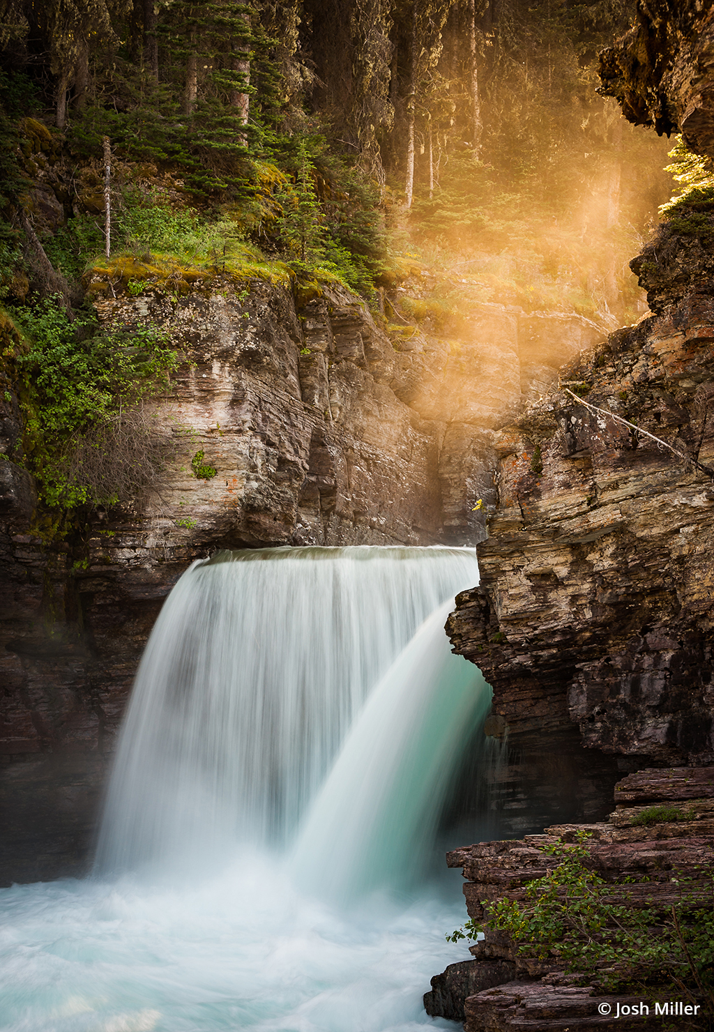 Using a telephoto was a better choice for this waterfall photograph than a wide-angle.