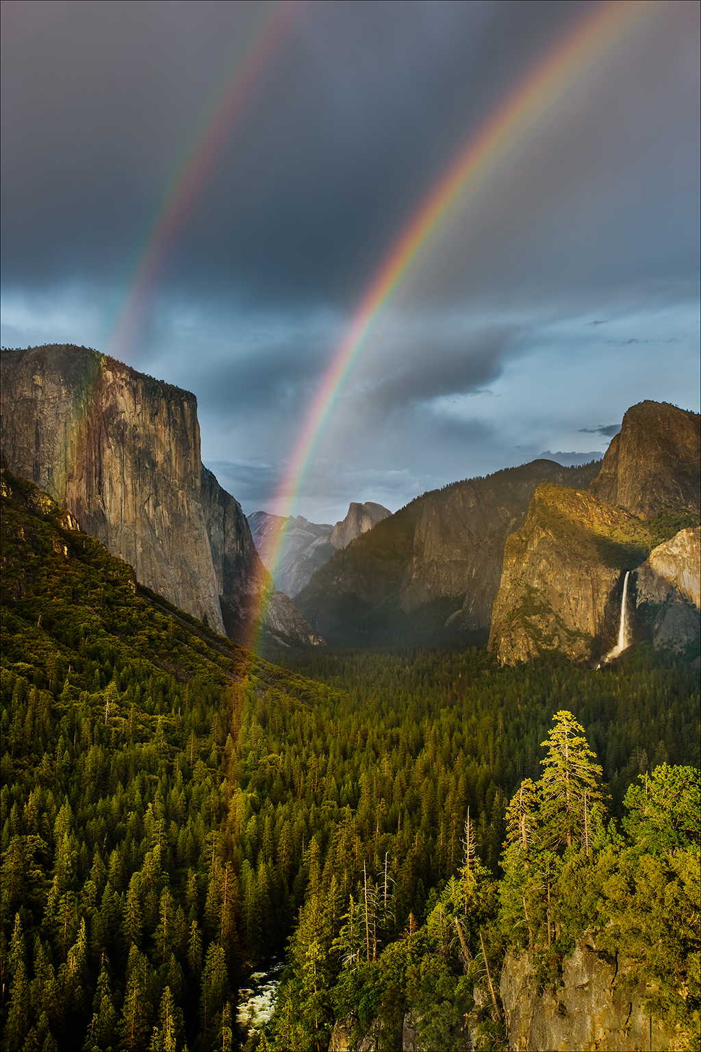 Image of a double rainbow after a lightning storm.