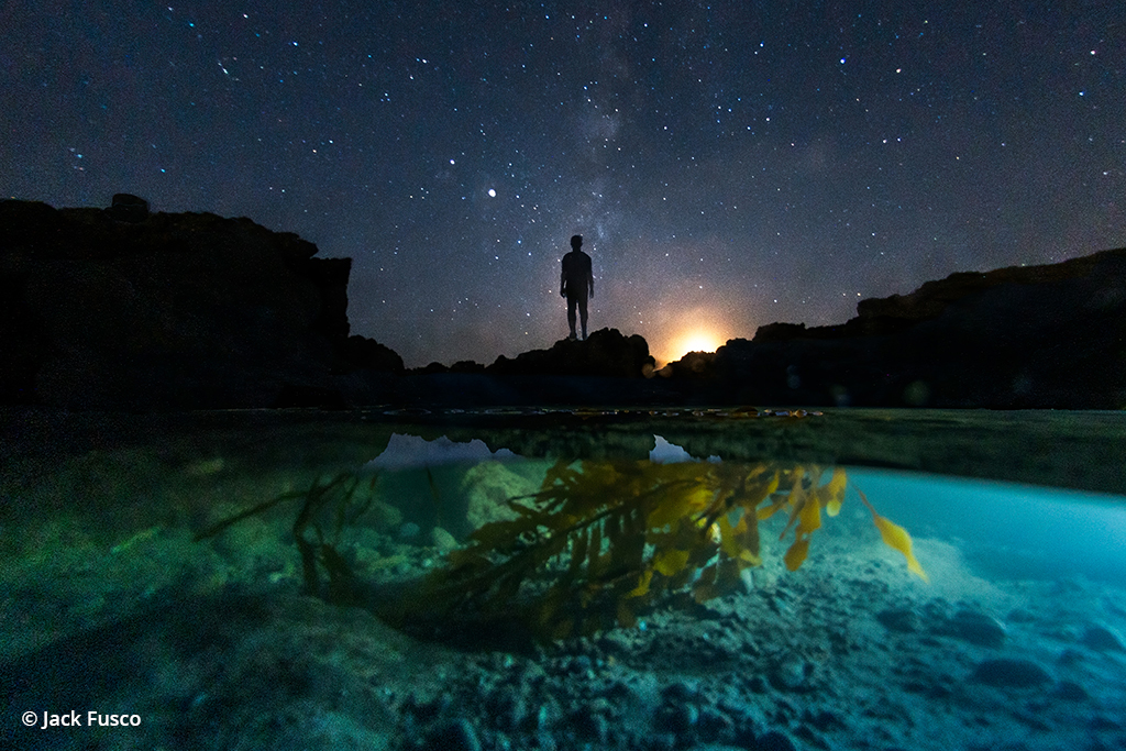 Astrophotography with an underwater scene in the foreground.