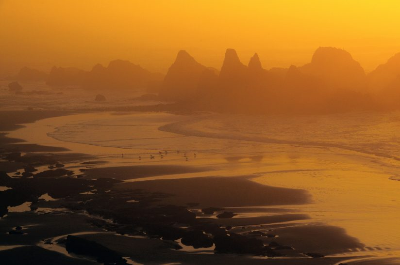 Misty Beach at Sunset