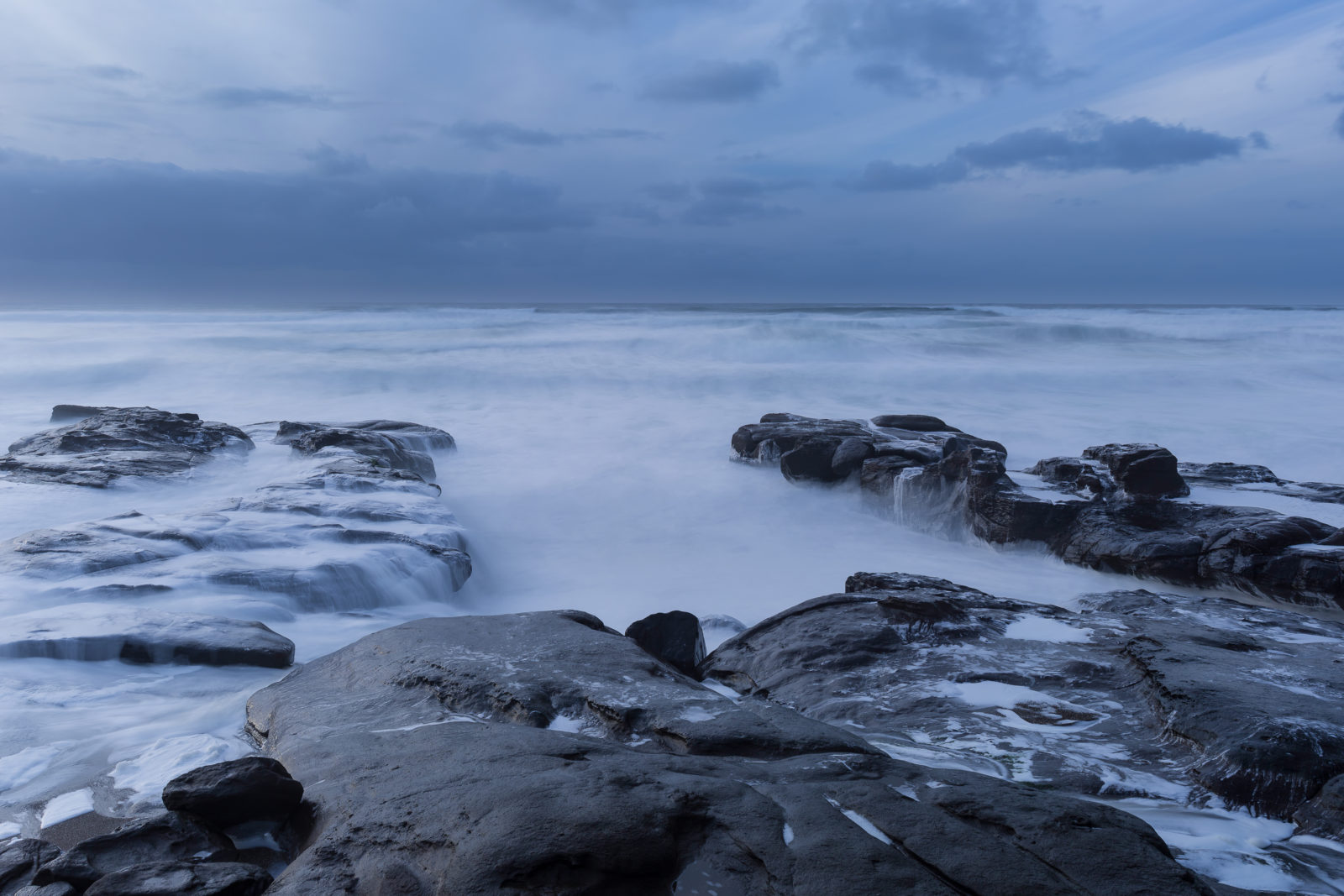 Staring at the rocks and winter ocean