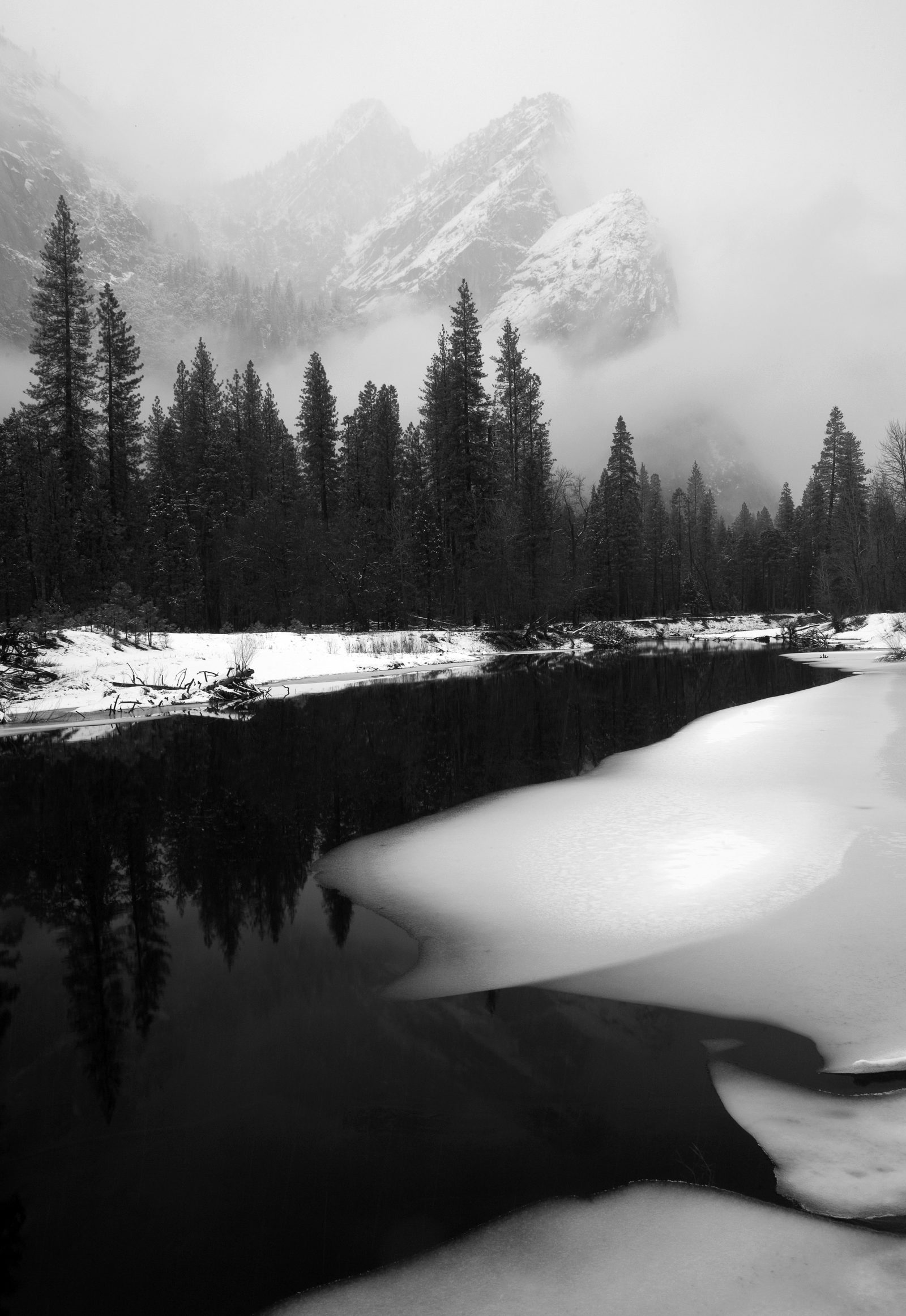 Three Brothers and Merced River in storm