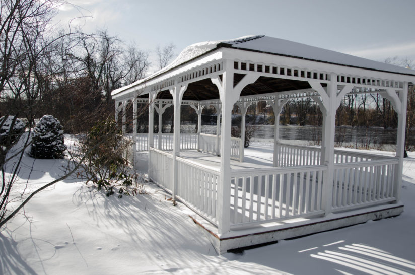 Gazebo by the river in Winter