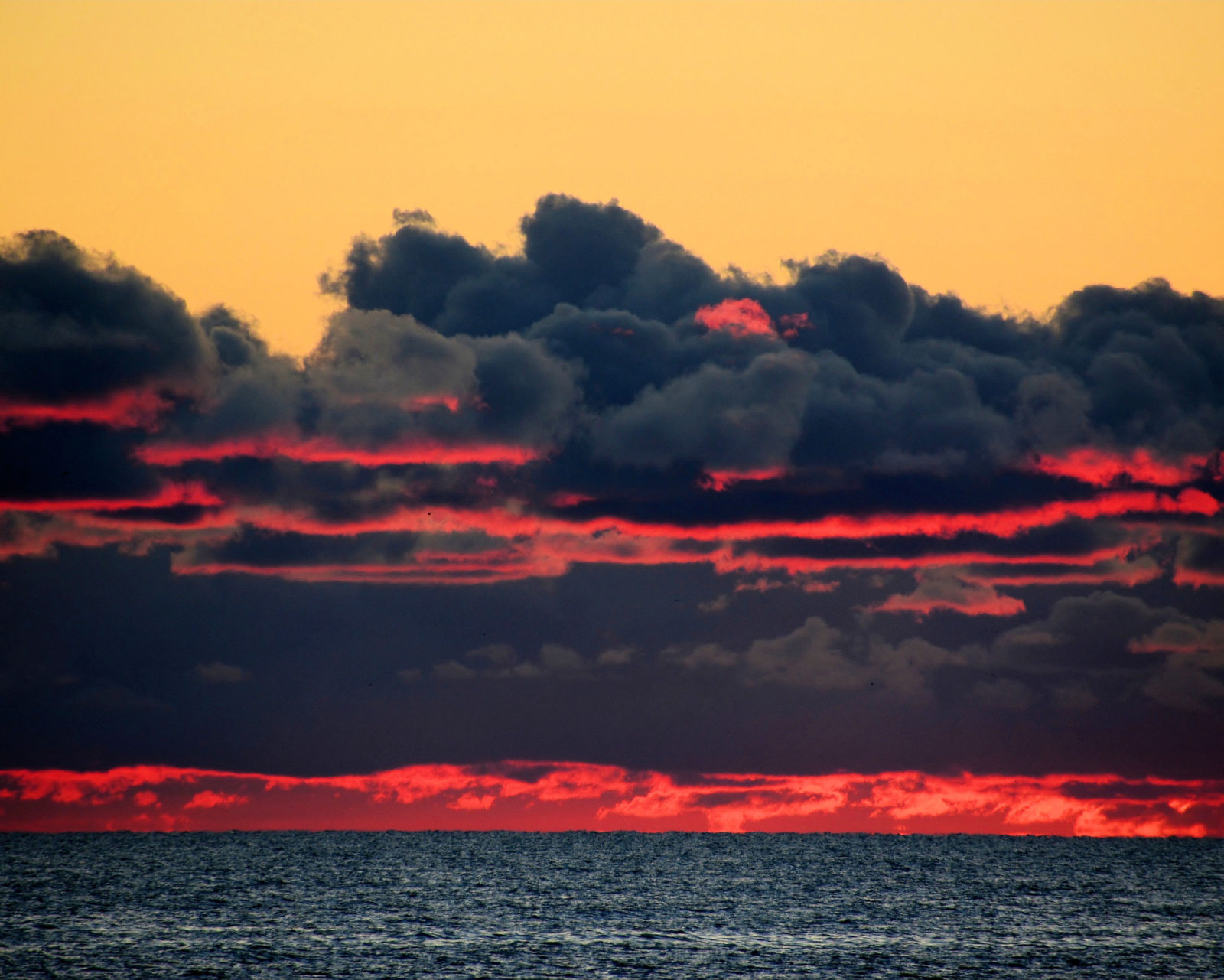 Sunrise Through The Clouds Over Lake Michigan