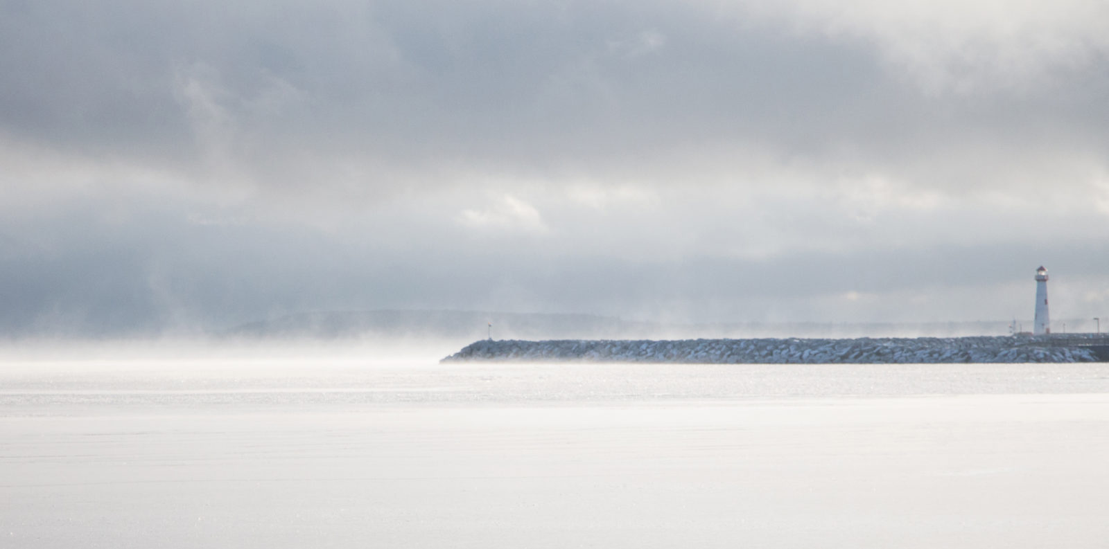 Lighthouse in a Winter Mist