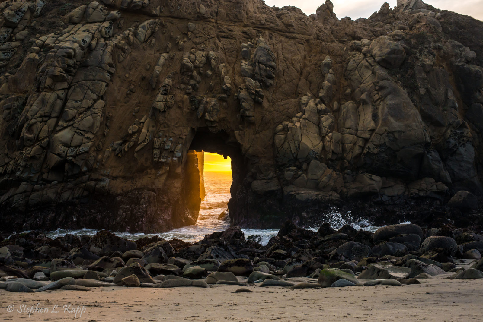 Sunset Rays through Keyhole Arch on Pfeiffer Beach