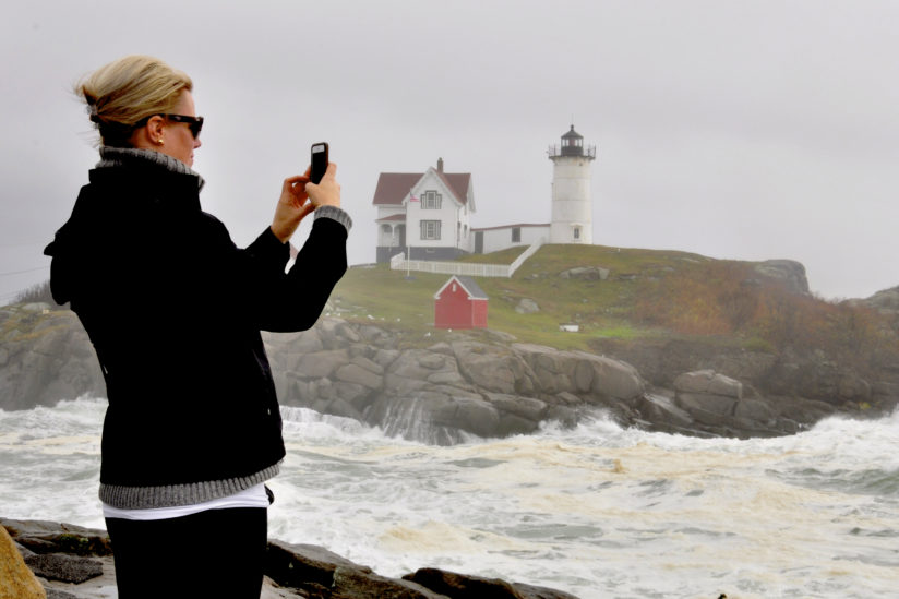 Autumn Tourist Photographing Nubble Lighthouse