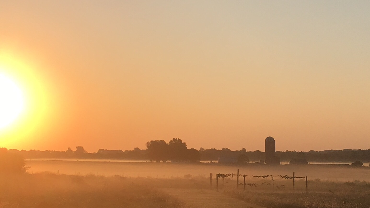 Sun coming up over the farm