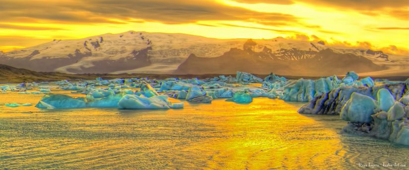 Golden Sunset over blue ice at Jökulsárlón