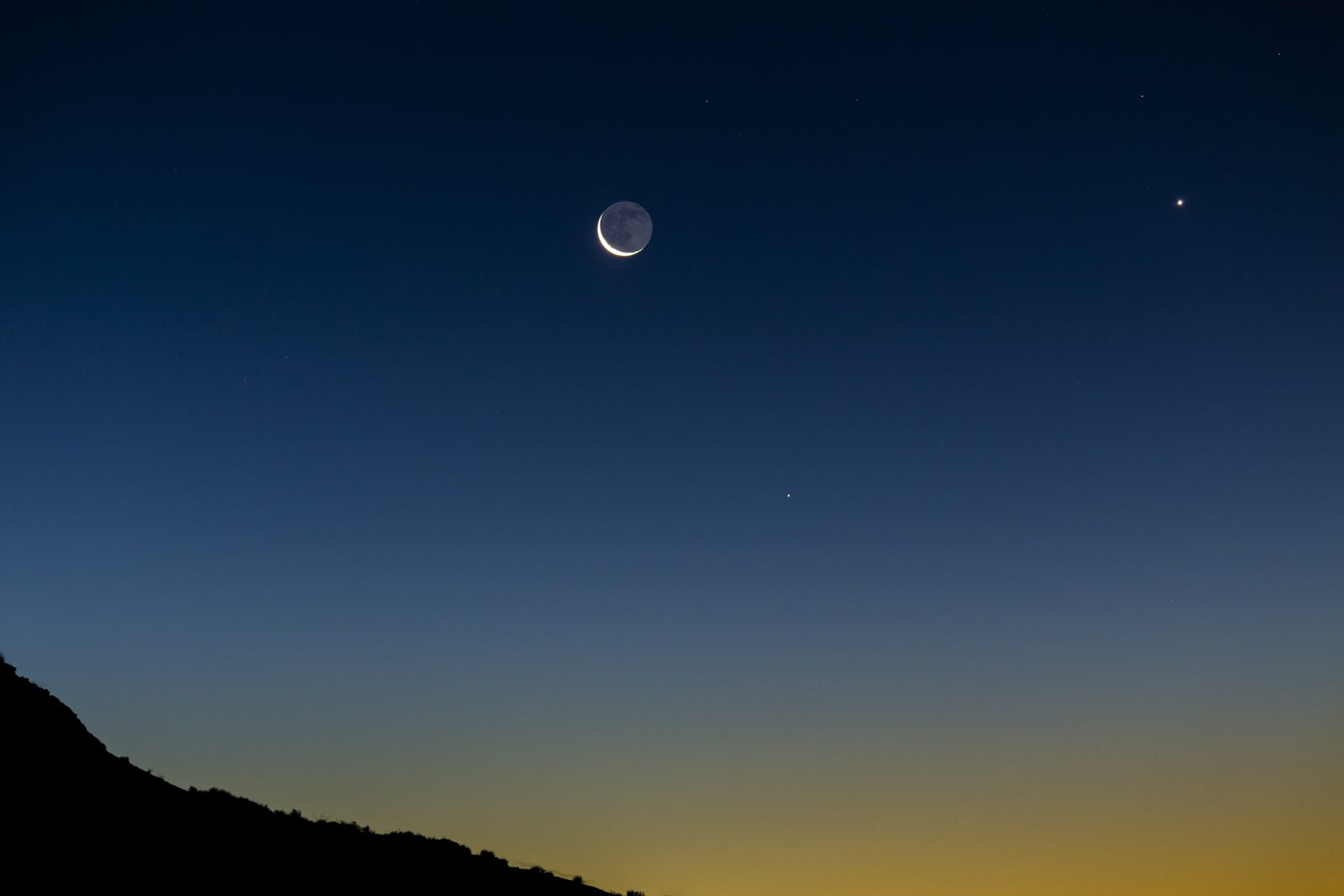 7% Crescent Moon with Venus and Morning Stars rise above Castle Butte in Valley of the Gods
