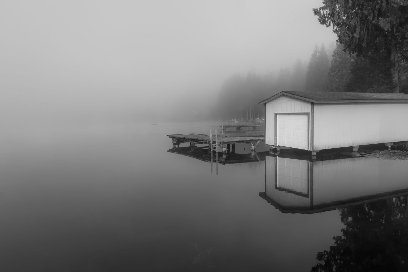 Boathouse in the fog