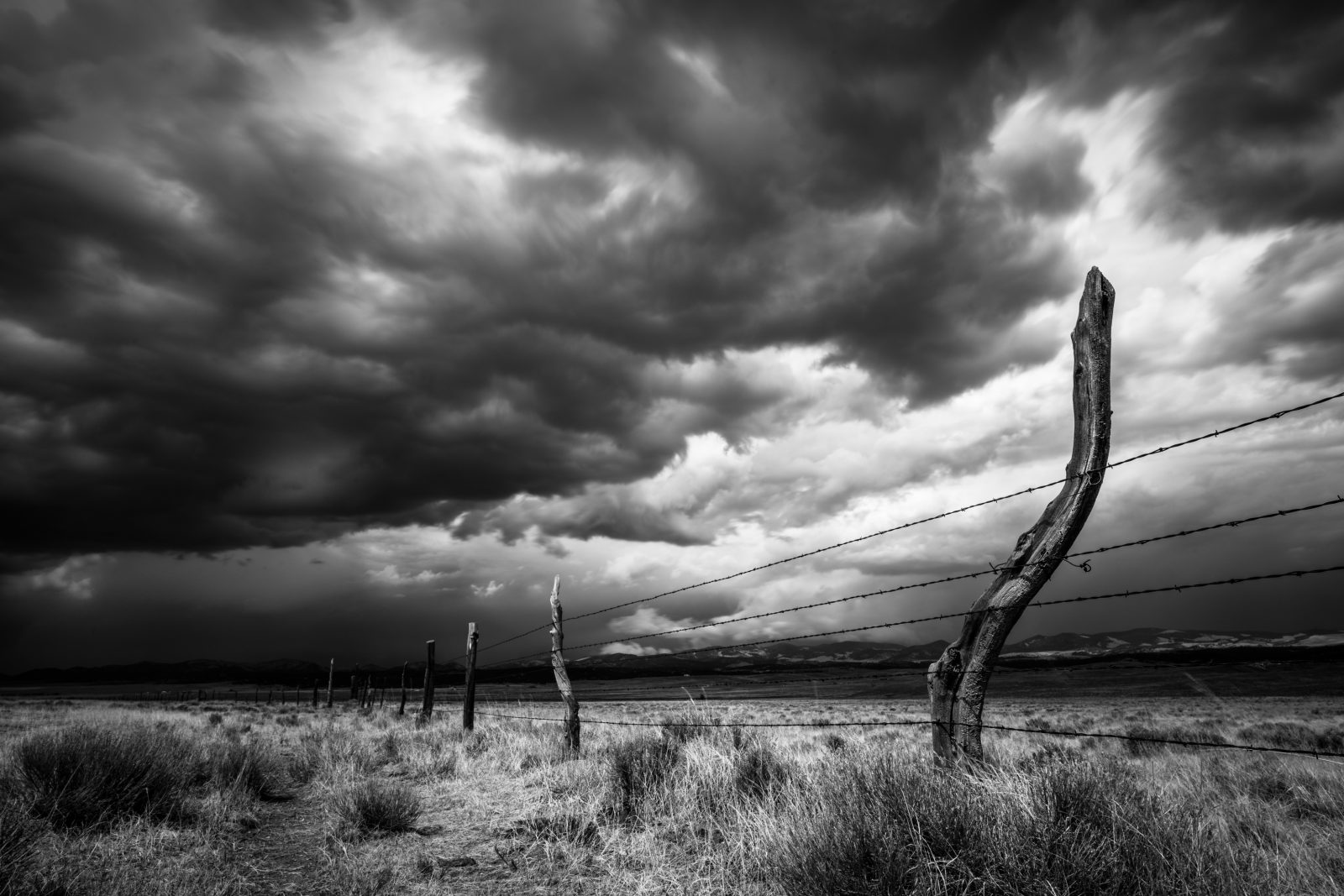 Angry Sky and Old Ranch Fence