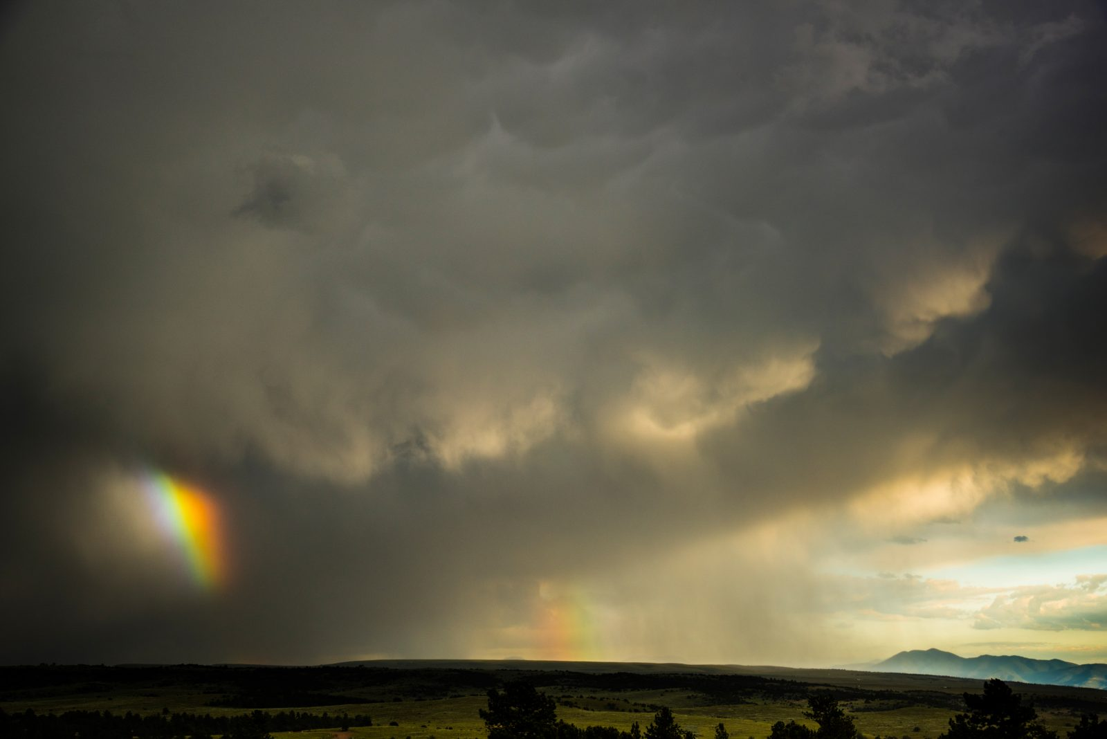 Rainbows and Storm over Valley