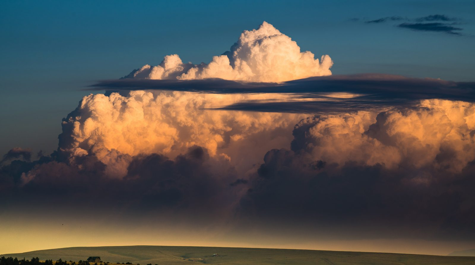 Sunset Storm Over Valley
