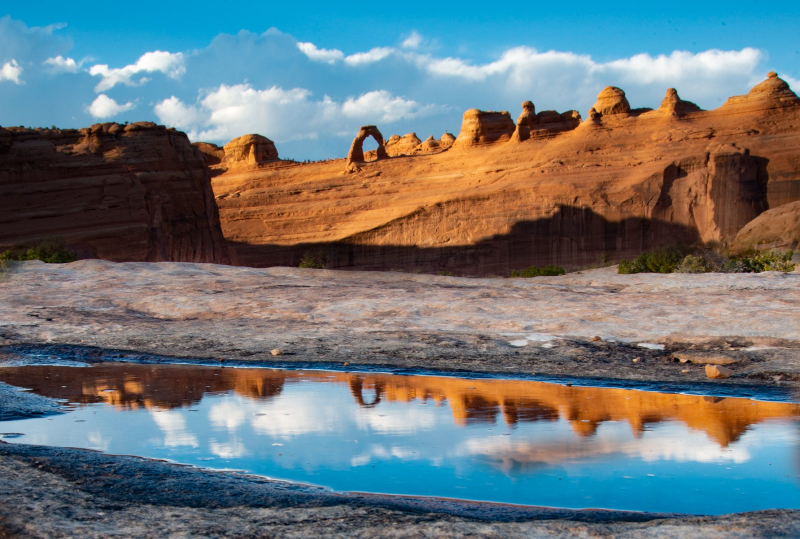 Pothole reflection of Delicate Arch