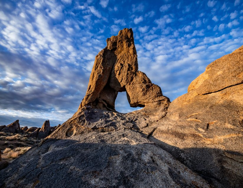 Dotted Clouds Over Boot Arch in the Alabama Hills, California.