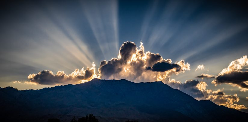 cerpuscular rays and puffy clouds