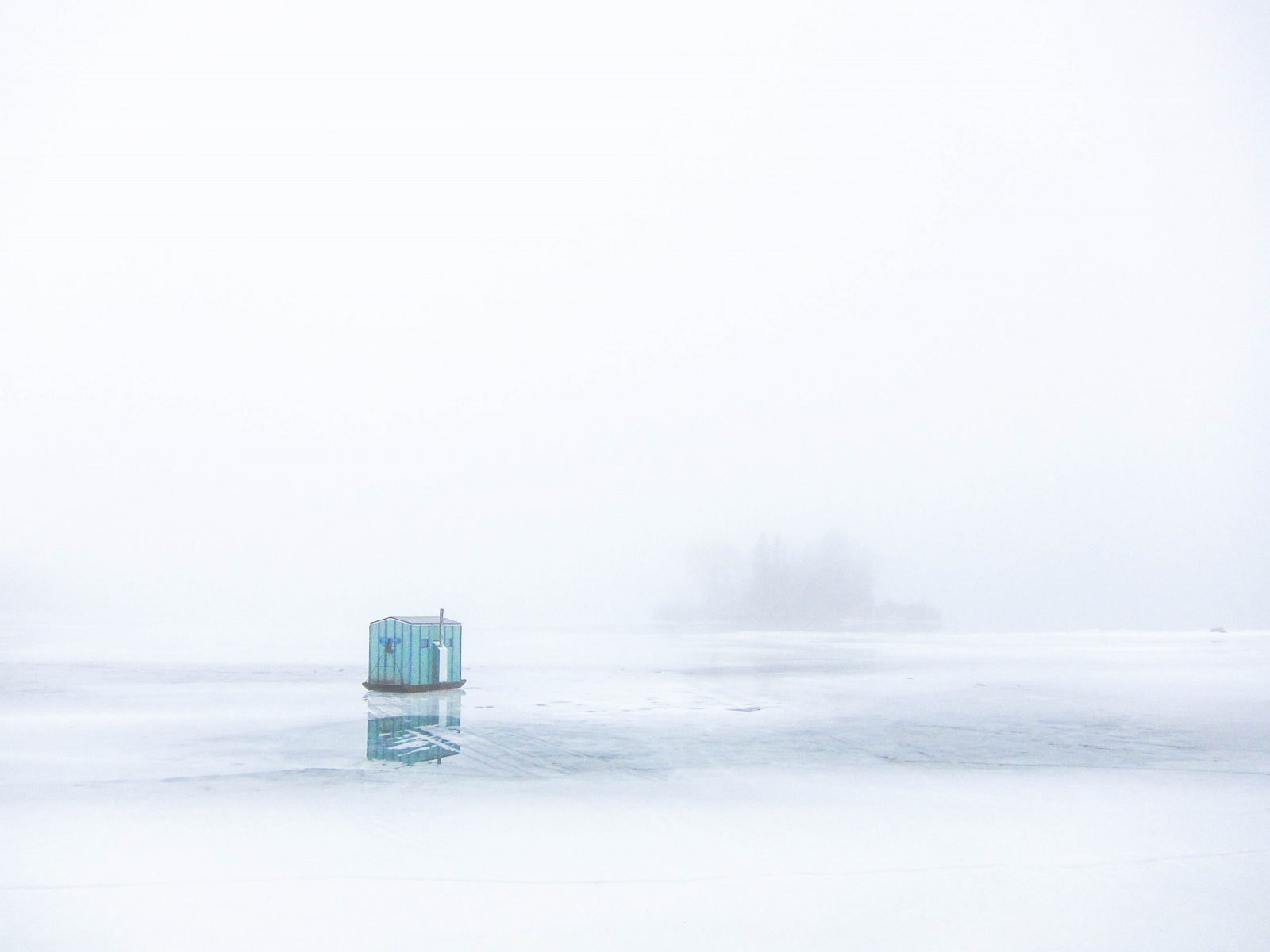 Ice Fishing on a Foggy Morning