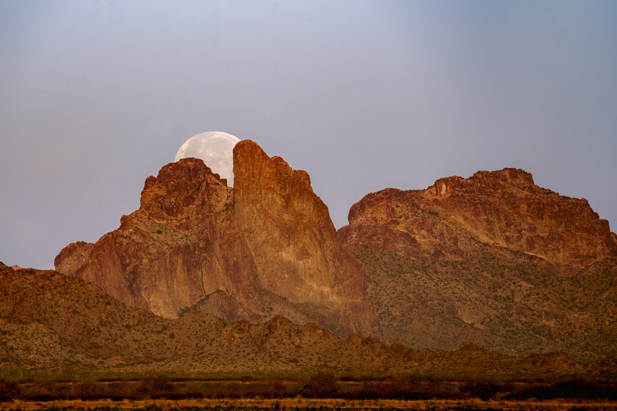 Snow Moon Setting Behind Courthouse Rock