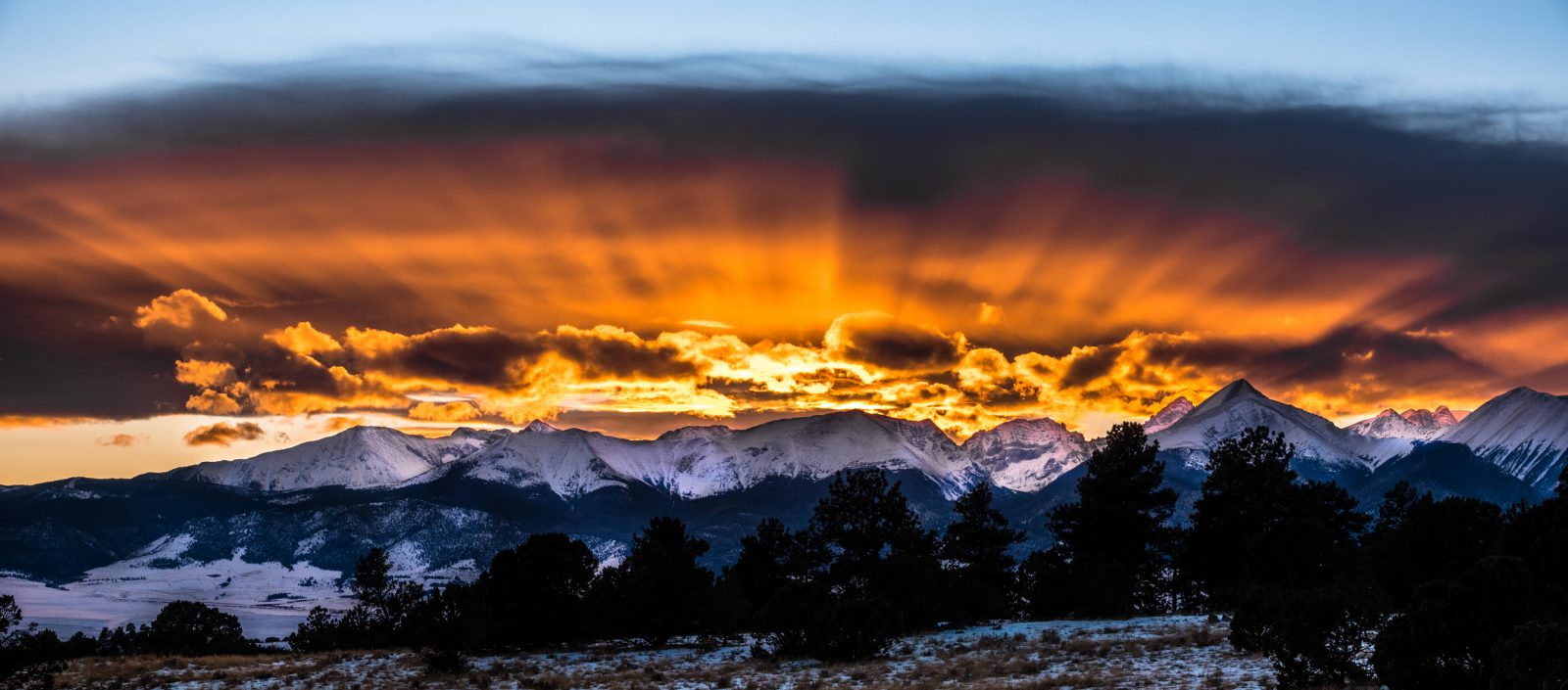 Sunset Rays Over Rocky Mountains