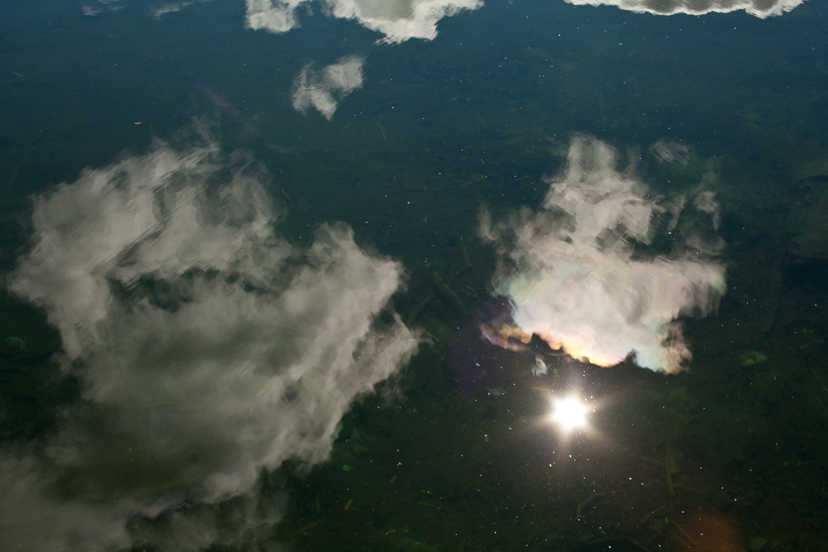 Clouds and Sunburst Reflection