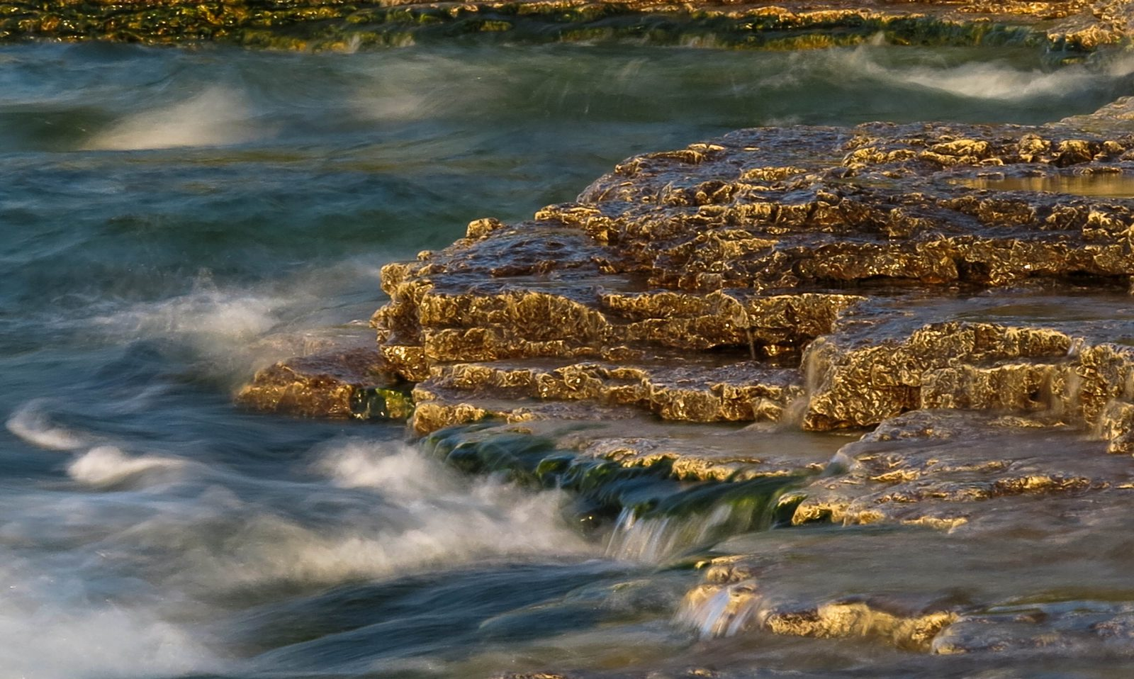 Waves Against the Rocks