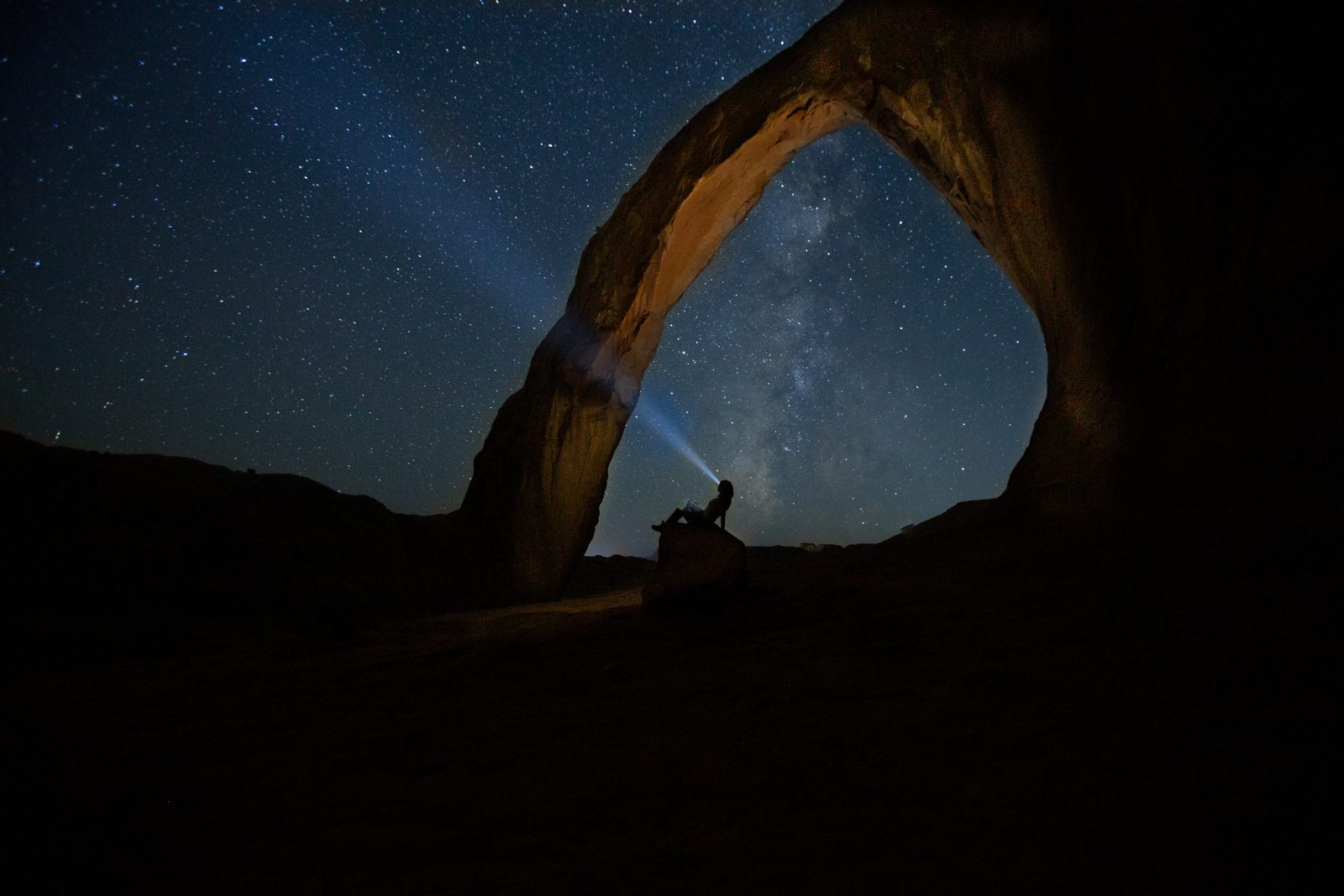 Corona Arch Night Sky with Milky Way and Girl with Headlamp