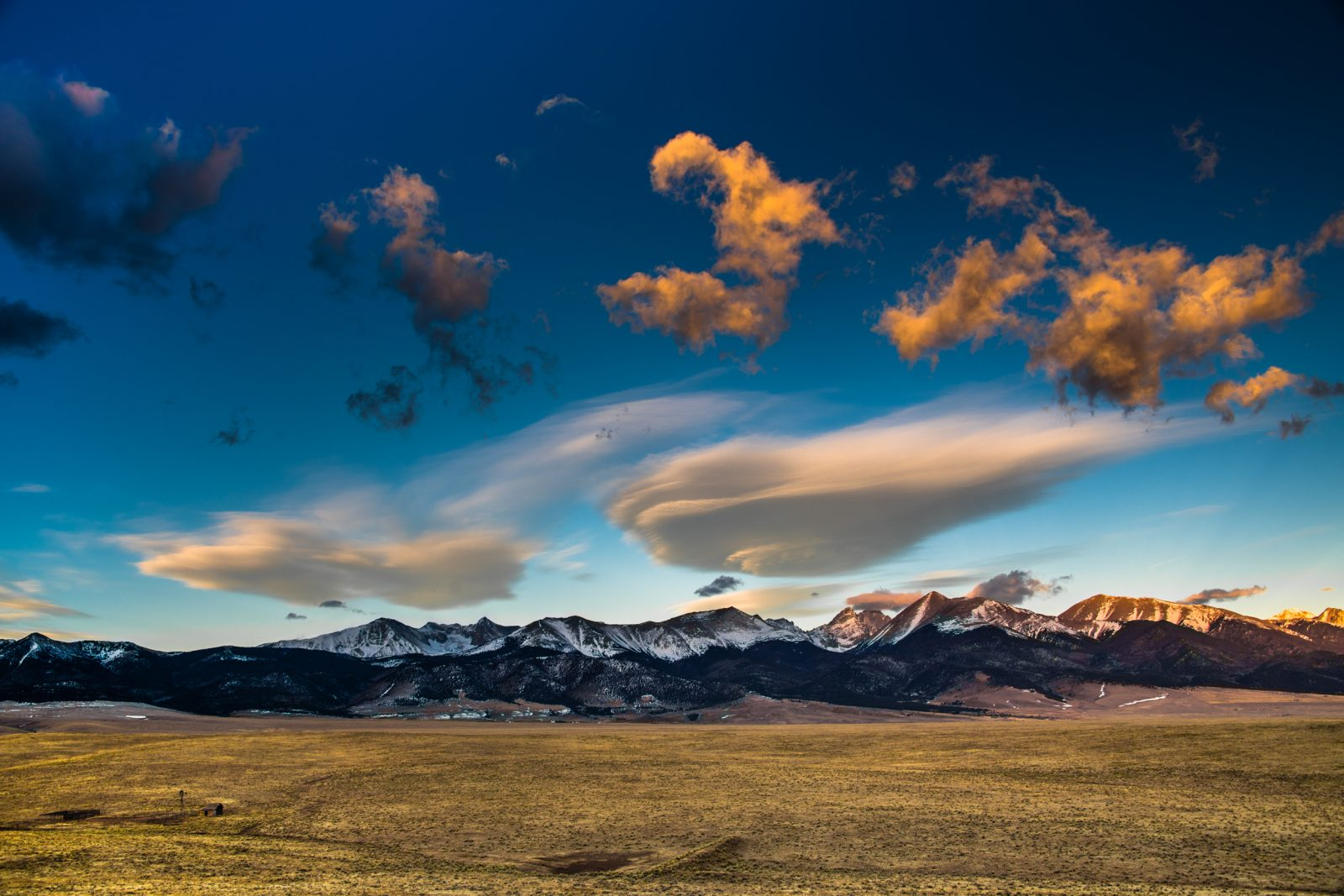 Sunrise Clouds Over Rockies