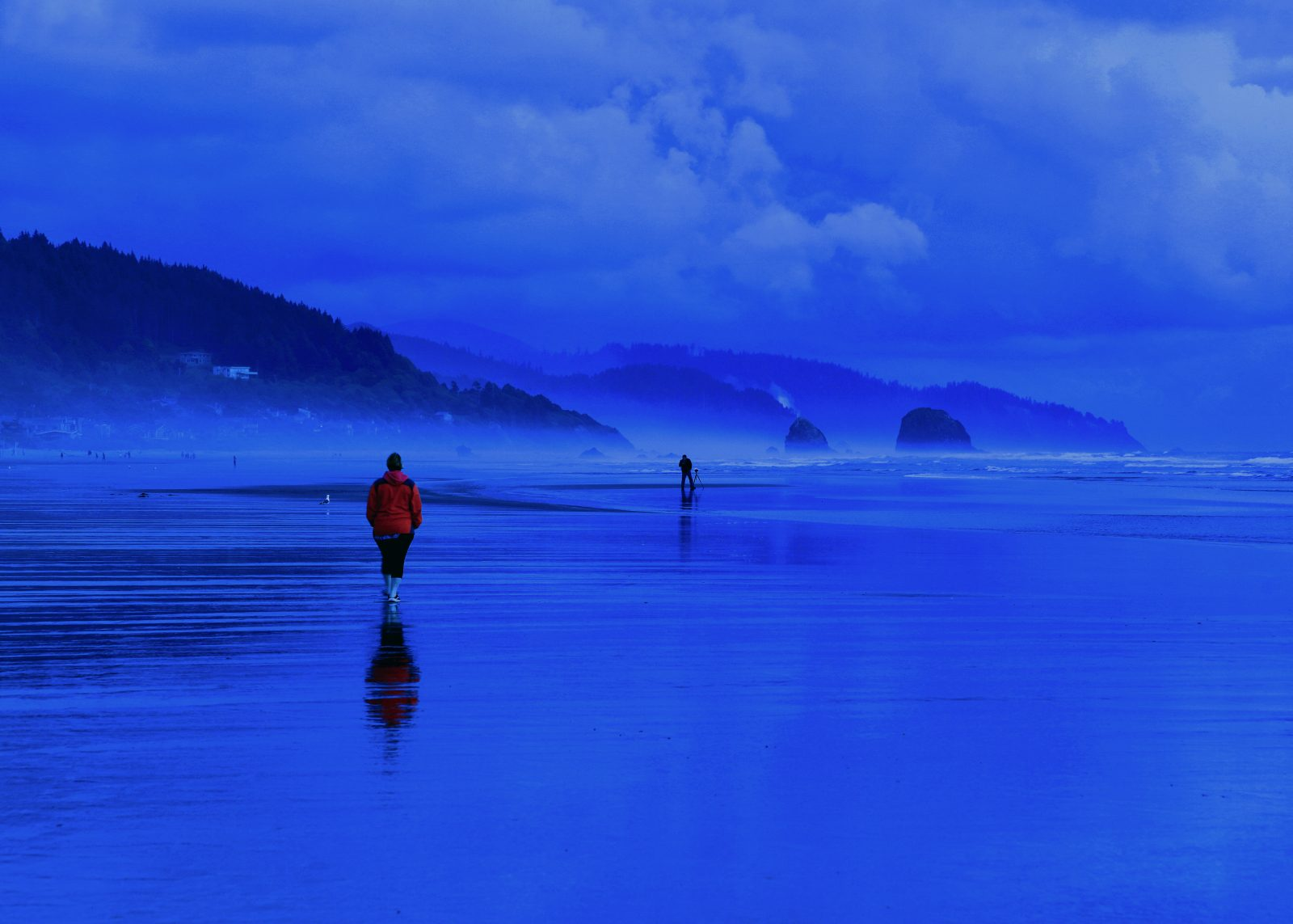 Lady in Red on Blue Beach
