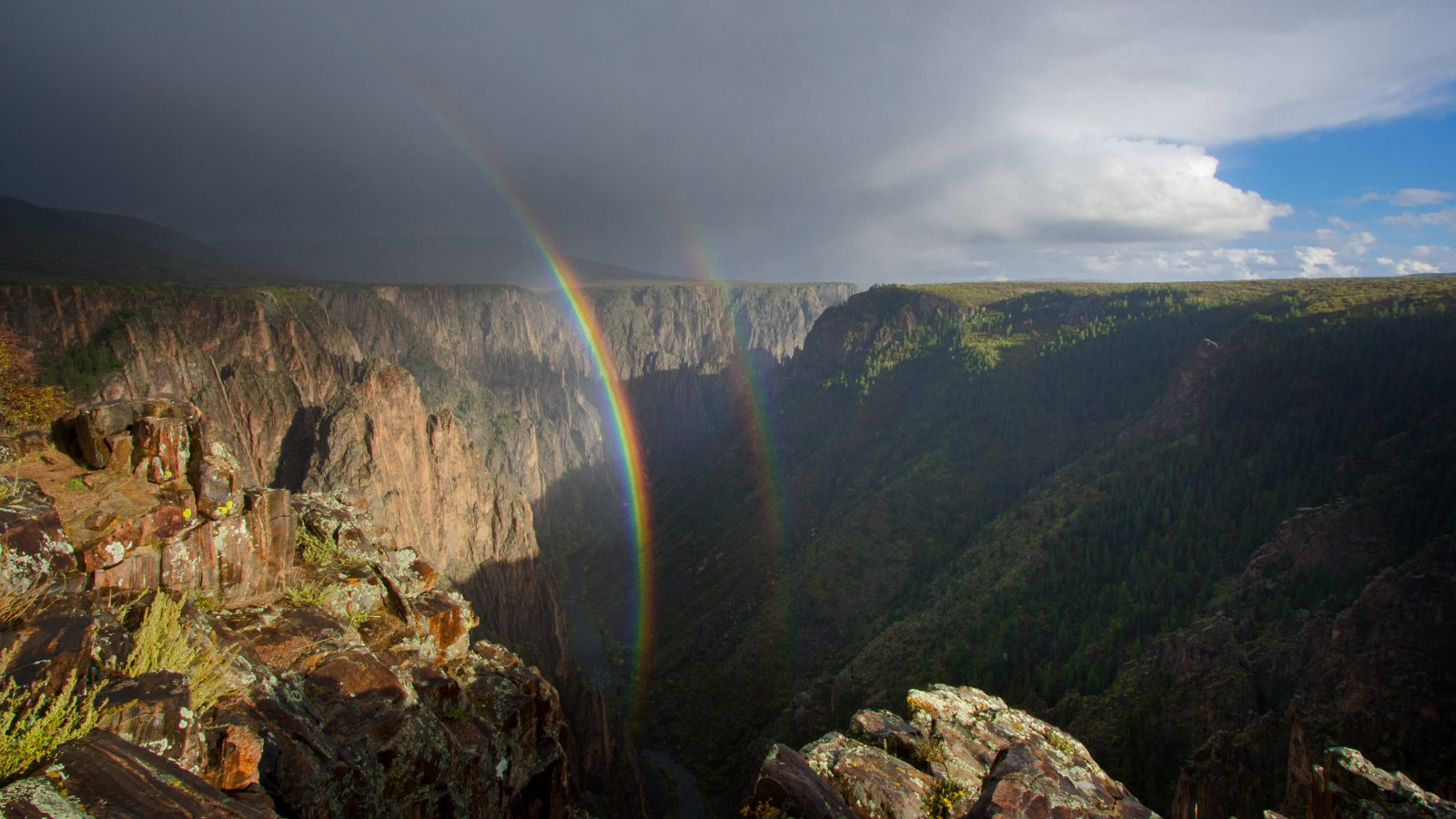 Light spills into the Black Canyon