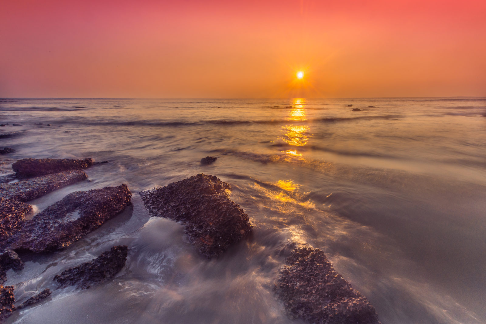 the sunset over sea beach in siant martin in bangladesh