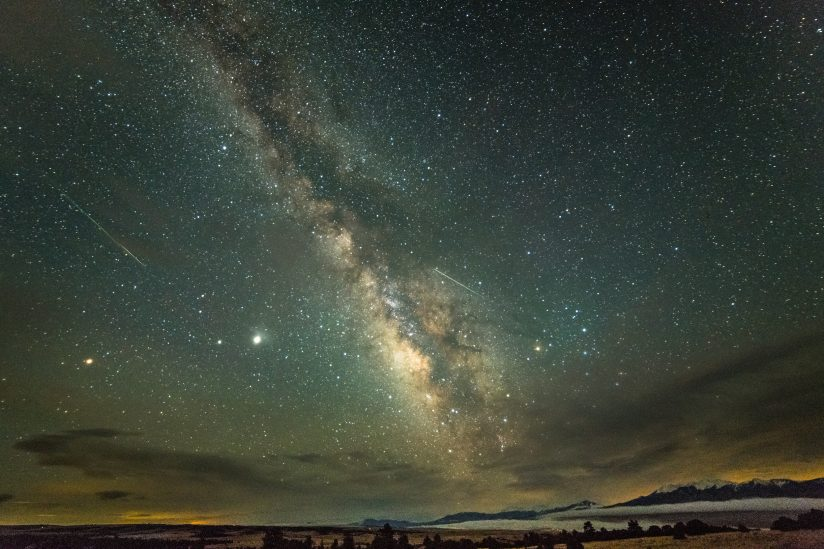 Two Meteors, Milky Way and Mountains