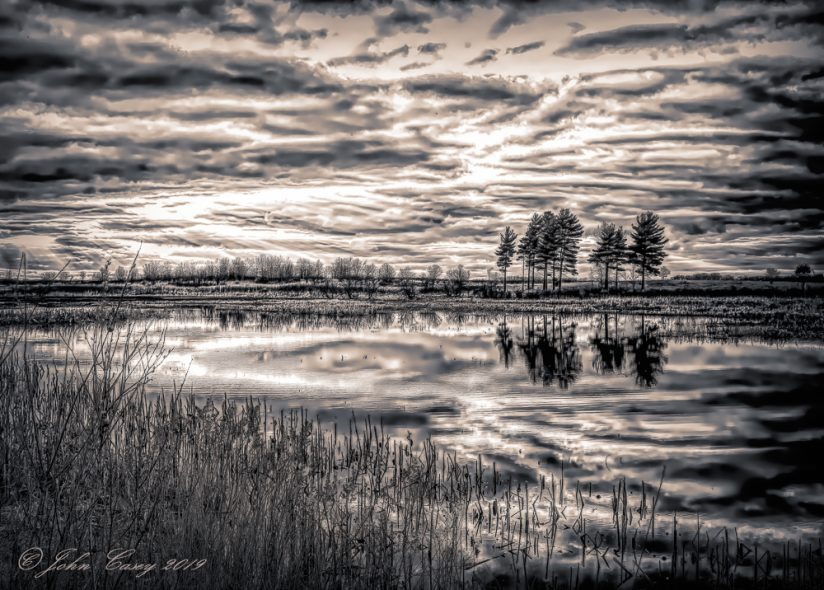 Storming Clouds gathering over a prairie pond