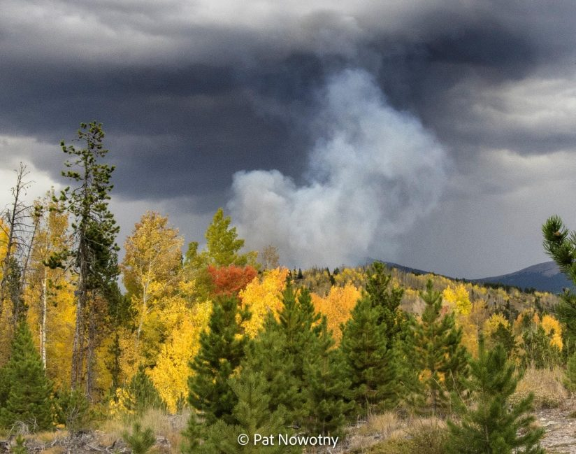 Wildfire smoke as storm clouds move in.